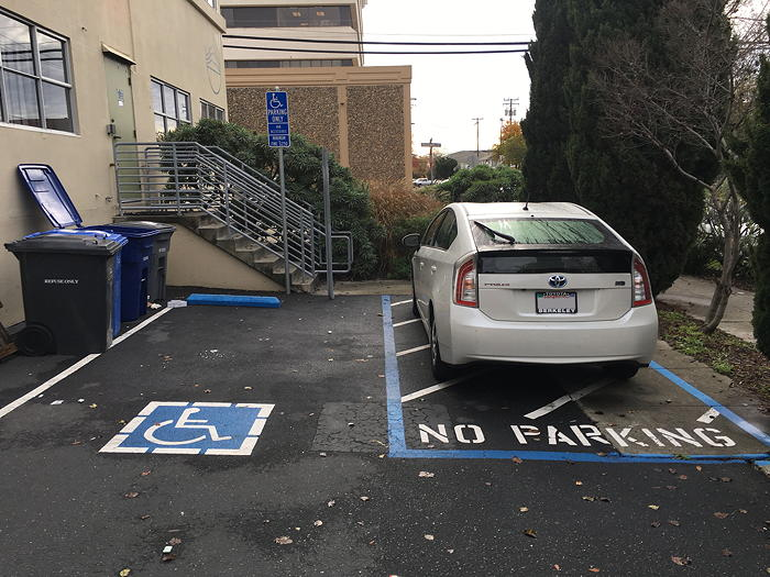 Car parked in van accessible area.