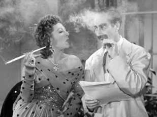 Grouch and a woman smoking tobacco in a cloud of smoke