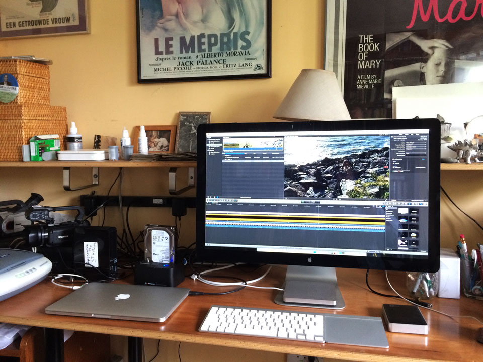 My desk. Showing laptop connected to thunderbolt monitor running Final Cut X