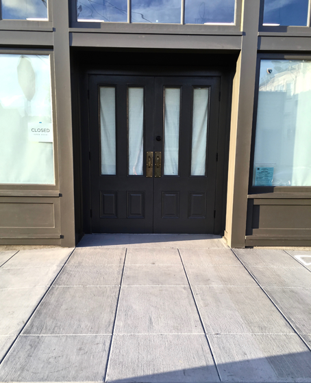 The front door of the store showing no step up.