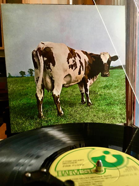 The record on the turntable with cover of Atom Heart Mother in background